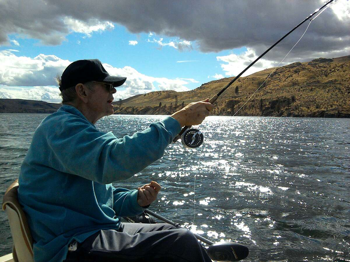 Legendary flyfisher Ed Rice, nearly blind, casts on his last trip to Rufus Woods Lake for large rainbow trout.