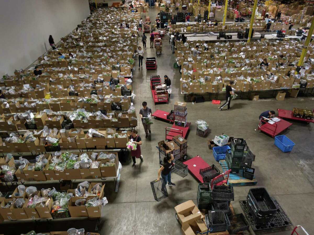 Workers fill orders at the Weee! warehouse in Union City, California.