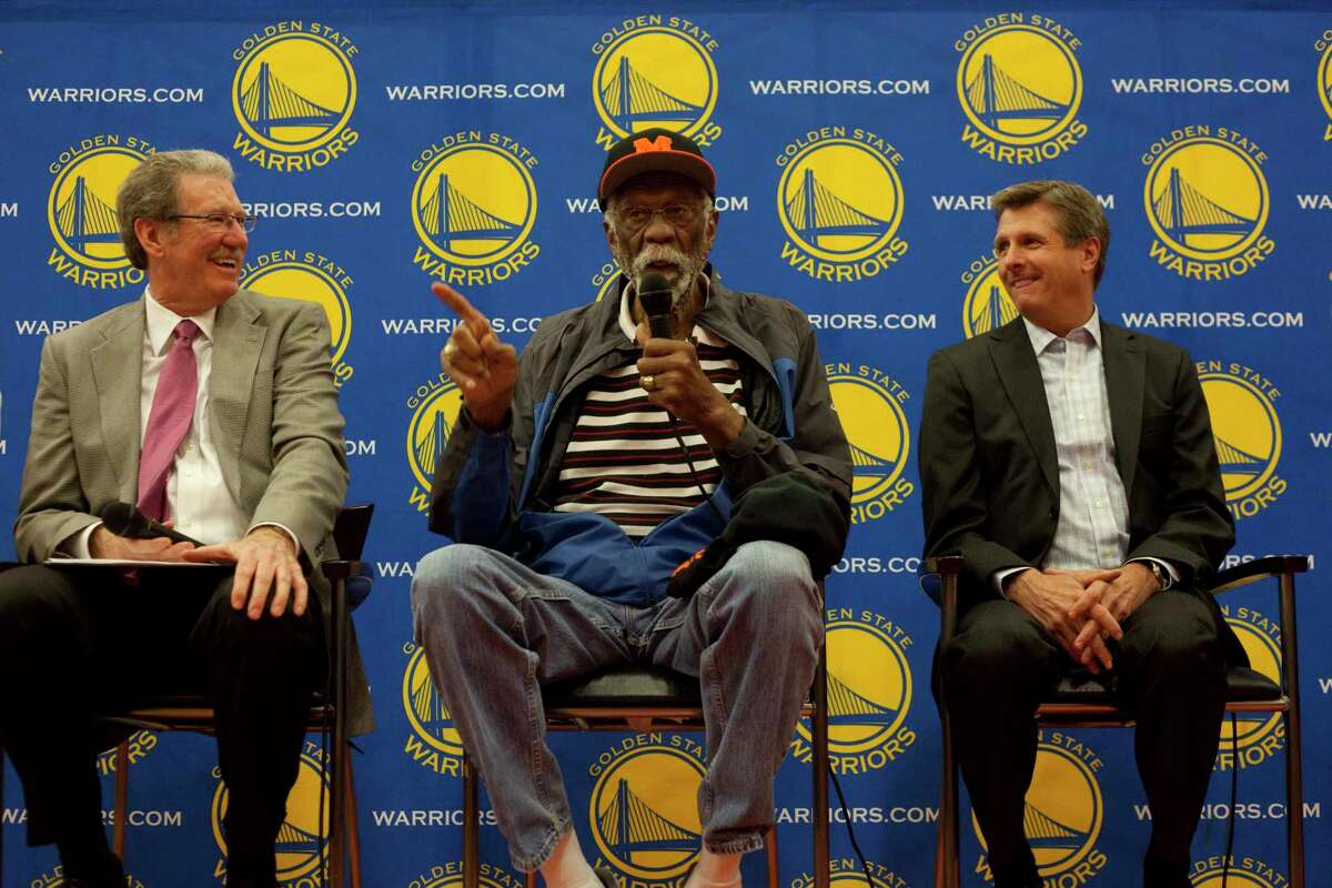 Jim Barnett, Bill Russell and Rick Welts during the unveiling event for the Bill Russell Wall of Champions at McClymonds high school in Oakland California on March 26th 2013. The event also included the unveiling of a newly renovated team room, weight room and aerobics room, in addition to a short practice led by current Warriors players Jarrett Jack and Harrison Barnes.