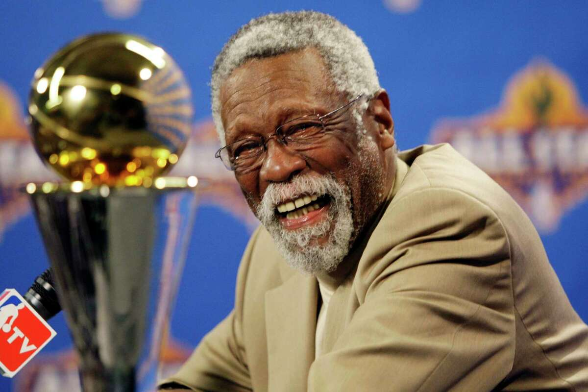 FILE - In this Feb. 14, 2009, file photo, NBA great Bill Russell reacts at a as he learns the most valuable player award for the NBA basketball championships has been renamed the Bill Russell NBA Finals Most Valuable Player Award during a news conference in Phoenix. Paul Pierce joins the basketball Hall of Fame, and Bill Russell goes in as a coach when the shrine holds its induction ceremony for the class of 2021 on Friday, Sept. 10, 2021. (AP Photo/Matt York, File)