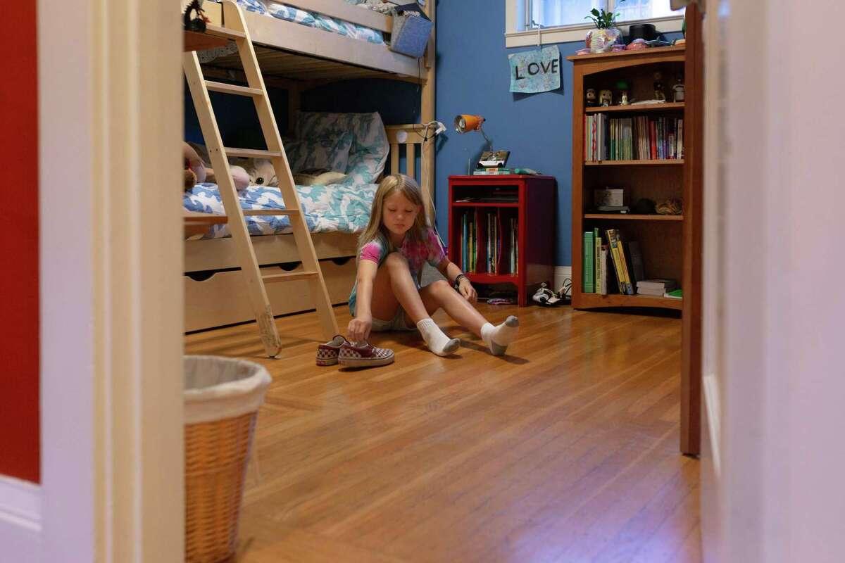 Beth Urbania gets ready for school in Albany.