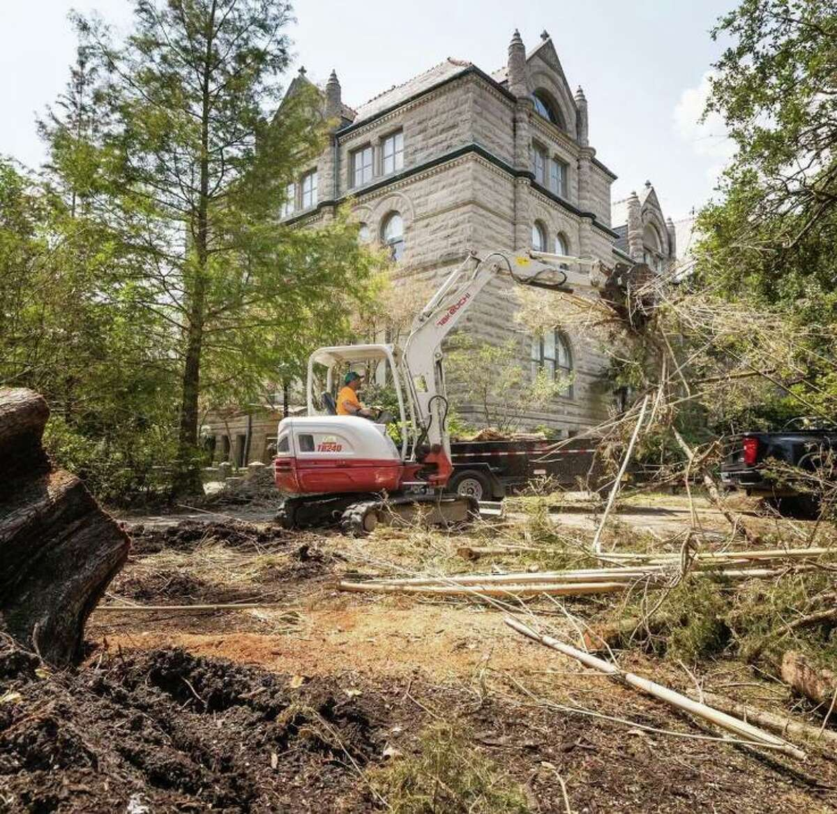 Crews remove fallen trees on campus at Tulane University in New Orleans after the devastating destruction caused by hurricane Ida.