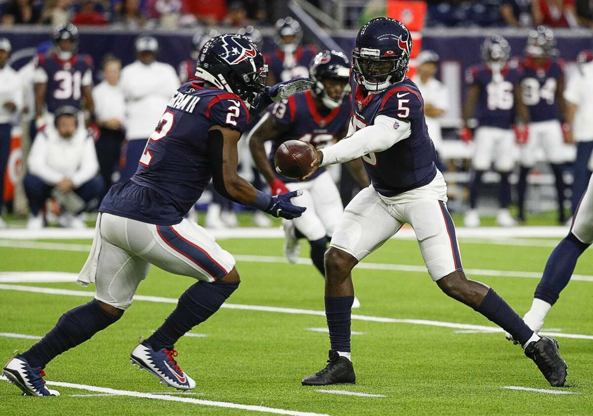 HOUSTON, TEXAS - AUGUST 28: Tyrod Taylor #5 of the Houston Texans hands off to Mark Ingram II #2 against the Tampa Bay Buccaneers during a NFL preseason game at NRG Stadium on August 28, 2021 in Houston, Texas.
