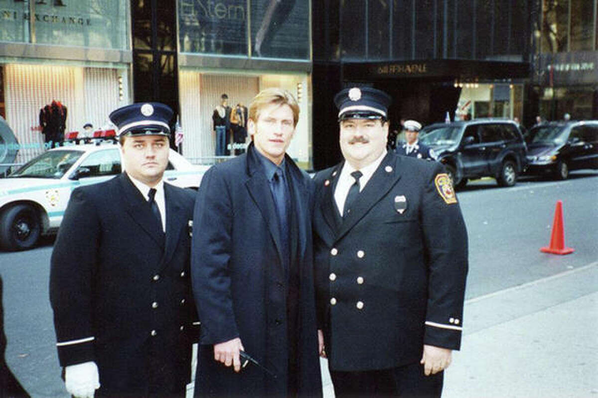 Edwardsville firefighters Bob Morgan, left, and Mike Picchioldi, right, with actor Dennis Leary in early November 2001 prior to the funeral service for New York City firefighter Capt. Patrick Brown at St. Patrick's Cathedral in Manhattan.