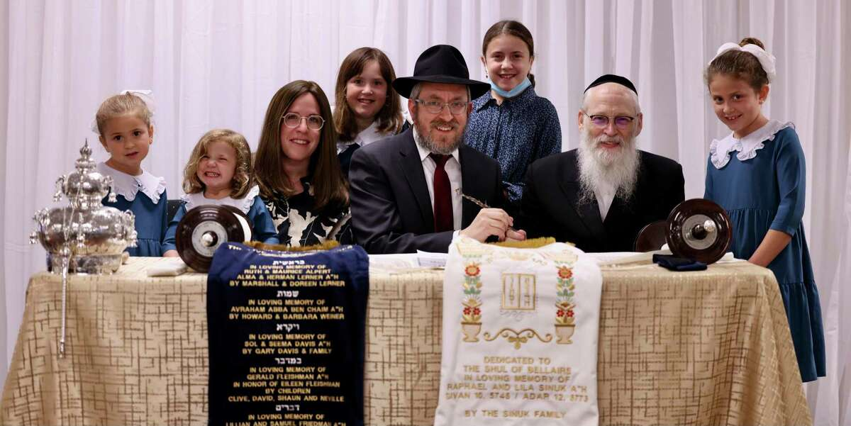 Esty and Rabbi Yossi Zaklikofsky, co-founders of The Shul of Bellaire, are joined by their daughters as they participate in the completion of the Unity Torah under the guidance of fifth-generation scribe Rabbi Moshe Klein.