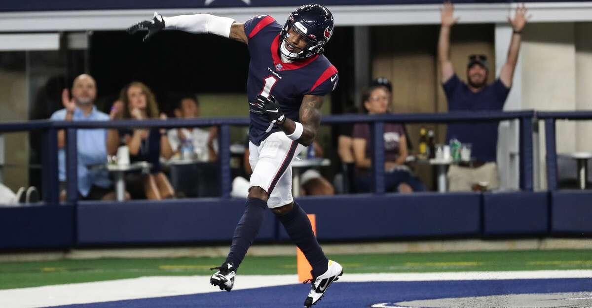 Houston Texans cornerback Lonnie Johnson Jr. celebrates his 53-yard interception return for a touchdown against the Dallas Cowboys during the second half of an NFL pre-season football game Saturday, Aug. 21, 2021, in Arlington.
