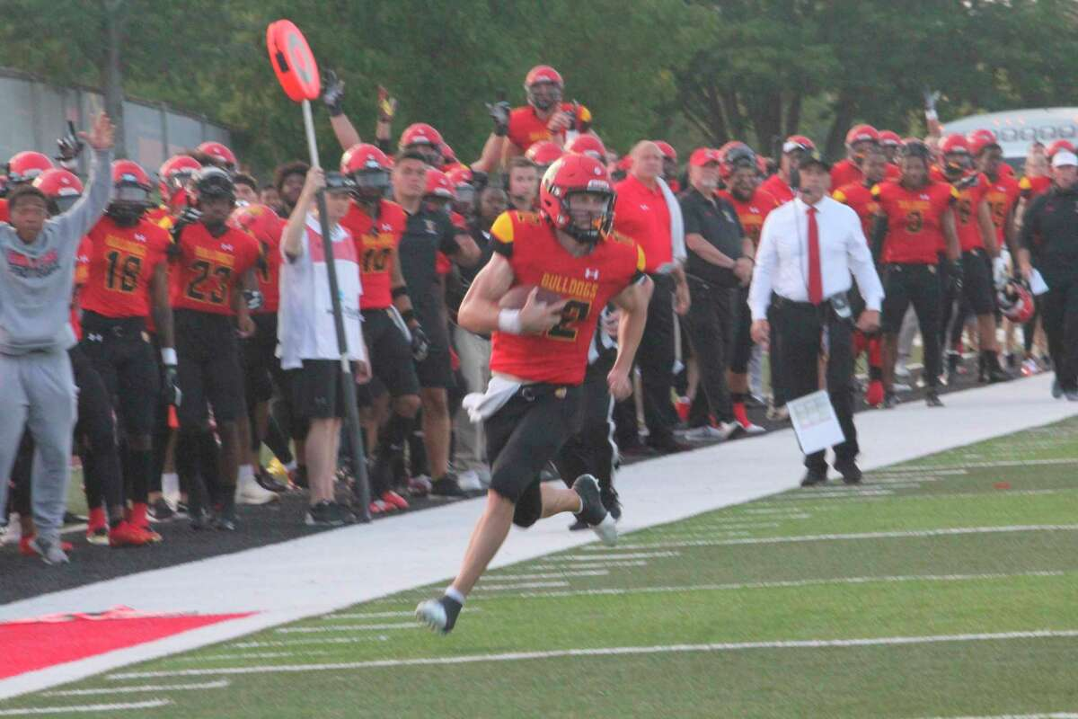 With coach Tony Annese watching in the background, Ferris quarterback Jared Bernhardt runs for a touchdown against Findlay in action on Sept. 2. (Pioneer photo/John Raffel)