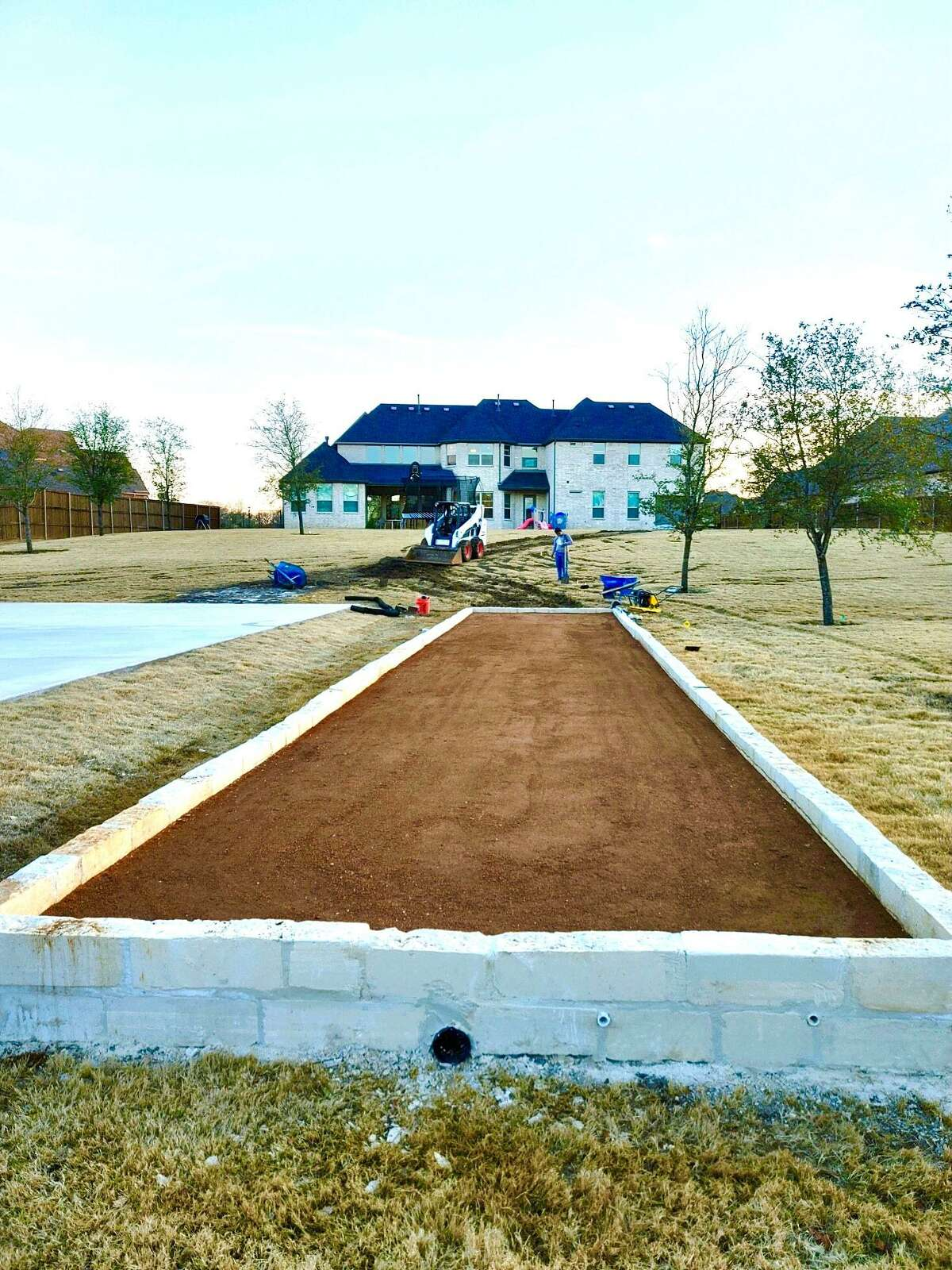 Chris Bailey's bocce court in the backyard of his Keller home has a crushed granite surface and limestone block edging. Bailey said he plays bocce two to three times a week.