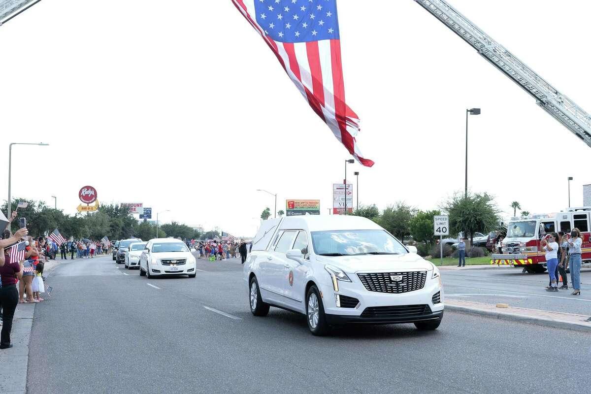 Car with Marine Lance Cpl. David Lee Espinoza's body drives through Del Mar Boulevard on Friday, Sept. 10, 2021.