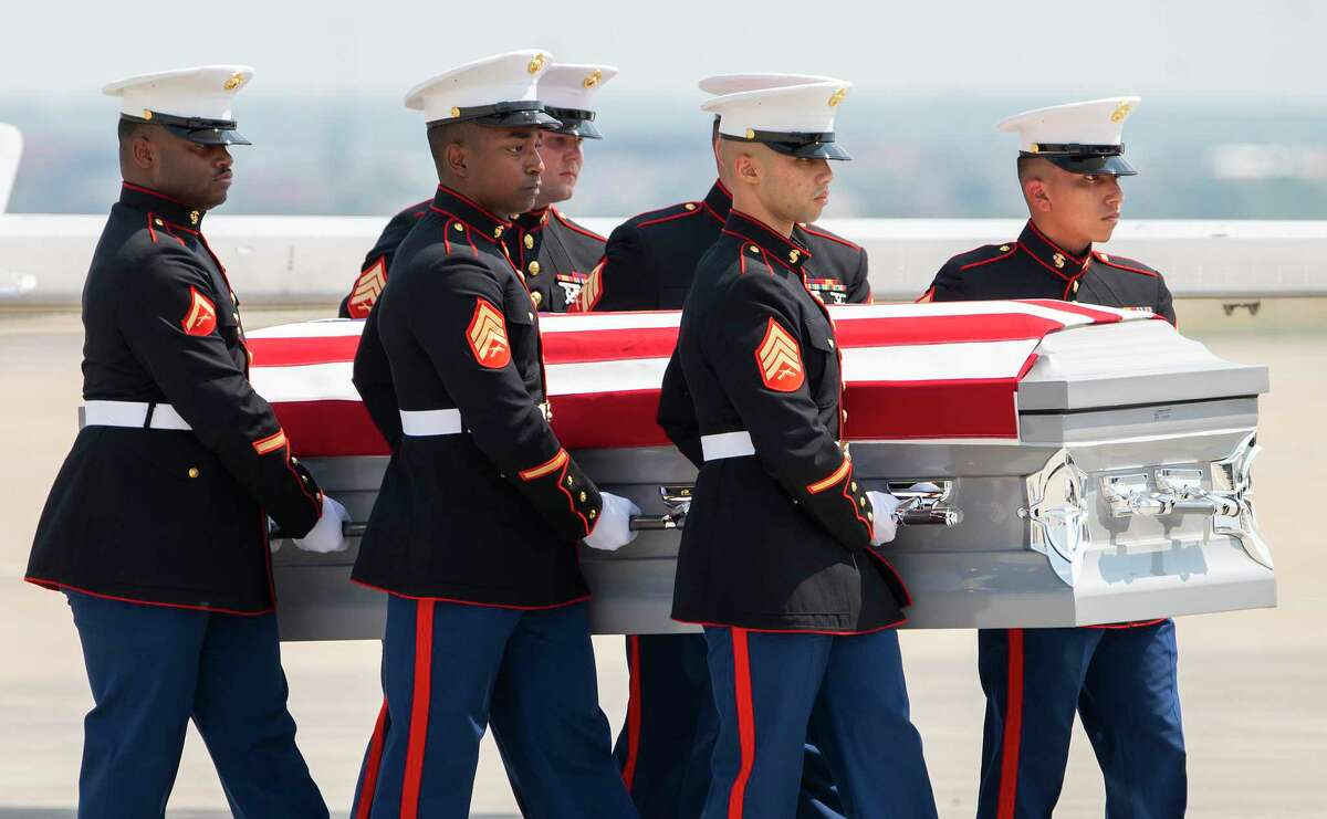 A group of United States Marines move the body of Lance Corporal David Lee Espinoza during a Dignified Transfer to the hearse, Friday, Sept. 10, 2021, after arriving at the Laredo International Airport.