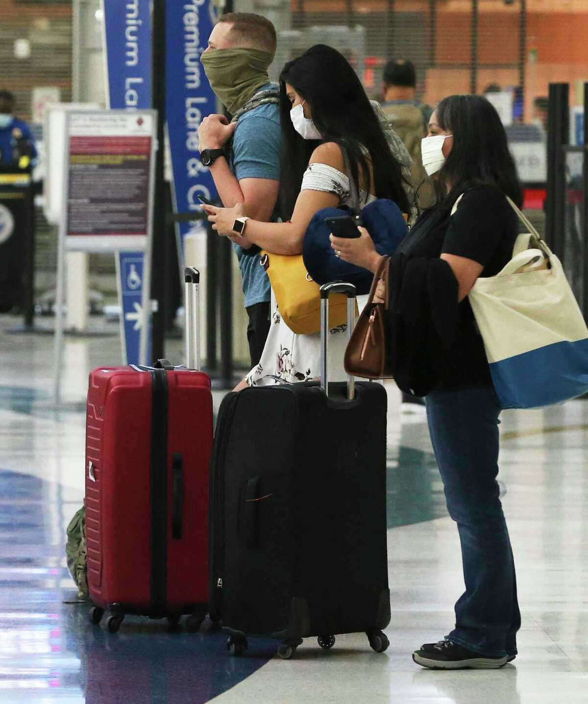 Travelers wait at the San Antonio International Airport in May. But the Austin-Bergstrom International Airport, just up the road, may keep San Antonio's airport from spreading its wings.