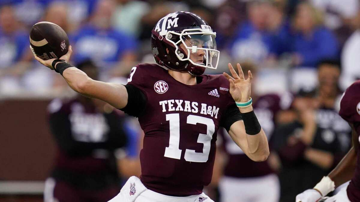 Texas A&M quarterback Haynes King (13) looks to pass against Kent State during the first half of an NCAA college football game, Saturday, Sept. 4, 2021, in College Station, Texas. (AP Photo/Sam Craft)