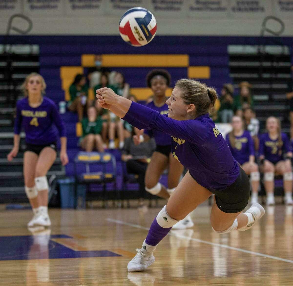 Midland High's Madison Zamora digs the ball Sept. 10, 2021 at Midland High School. Jacy Lewis/Reporter-Telegram