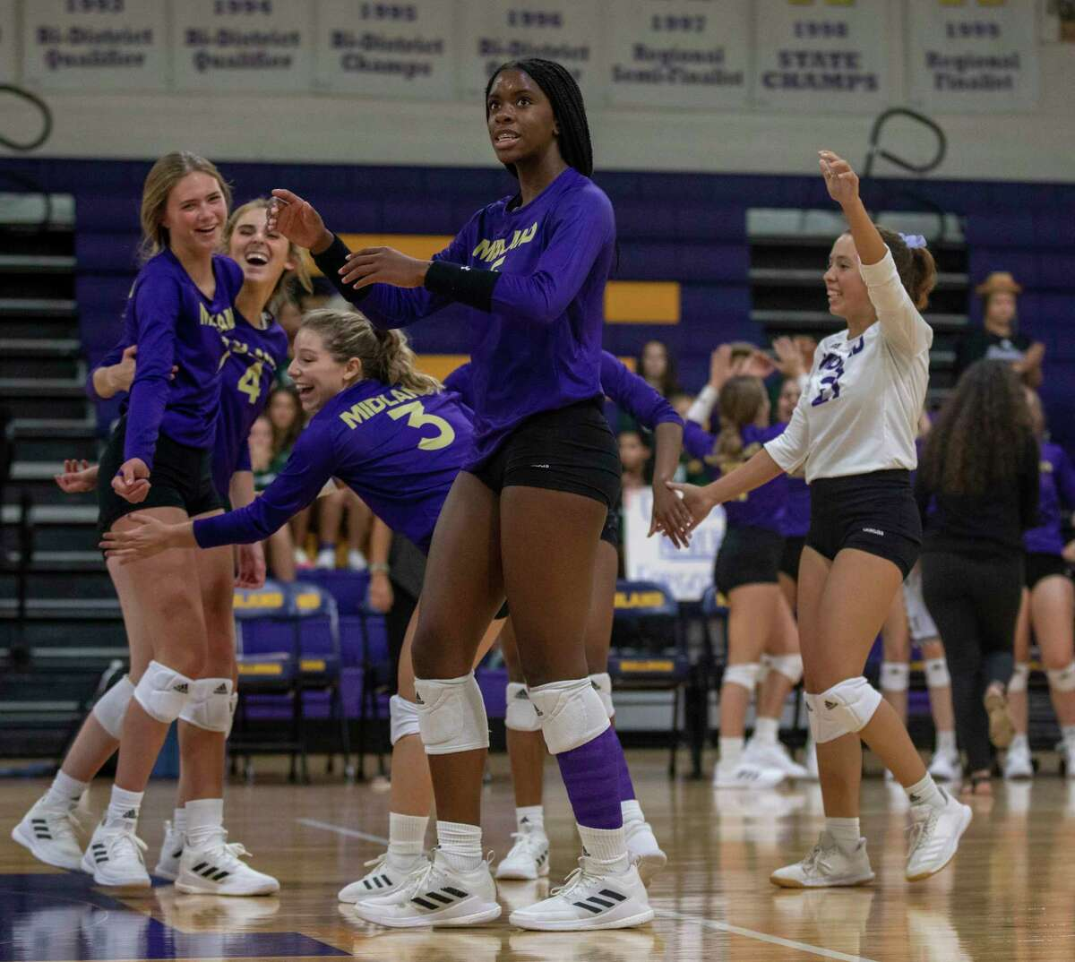Midland High players celebrate a point Sept. 10, 2021 at Midland High School. Jacy Lewis/Reporter-Telegram