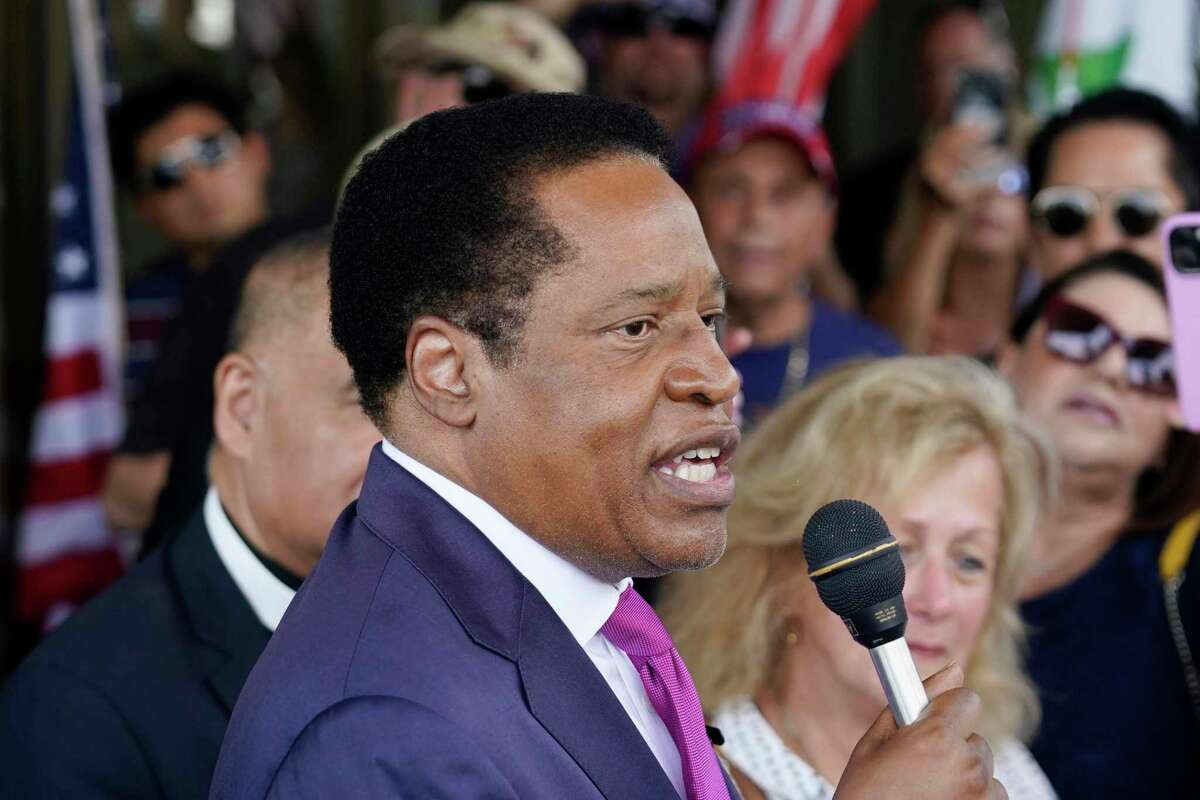 Gubernatorial candidate and radio talk show host Larry Elder speaks to supporters during a campaign stop in Norwalk (Los Angeles County) in July.