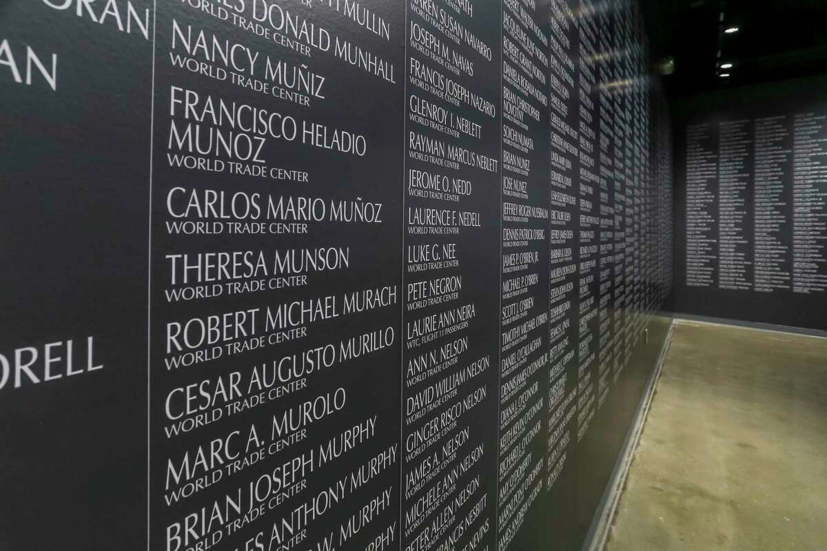 """The names of the 2,997 people that were killed during the 9/11 attacks are on display in the exhibit """"Never Forget: Commemorating the 20th Anniversary of 9/11"""" on September 4, 2021 at the Lone Star Flight Museum in Houston, TX."""