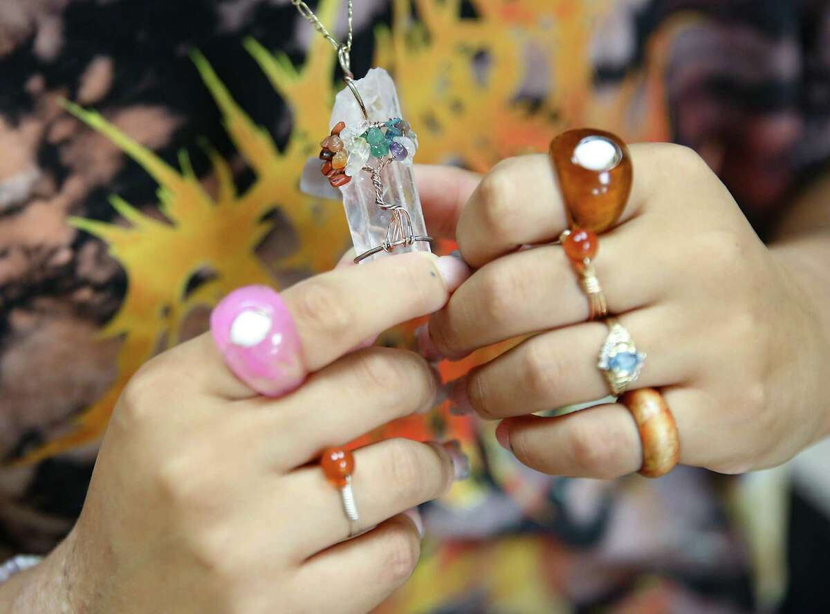 Artist Lyrik Lazard, who evacuated New Orleans with three friends, shows some of her jewelry.