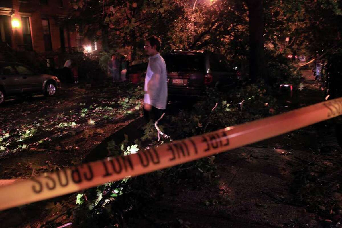 NEW YORK - SEPTEMBER 16: Downed trees and other debris lie on a street in Park Slope following a late afternoon storm on September 16, 2010 in the Brooklyn borough of New York City. At least one fatality was attributed to the severe storm that brought high winds and rain and possibly a tornado. (Photo by Spencer Platt/Getty Images)