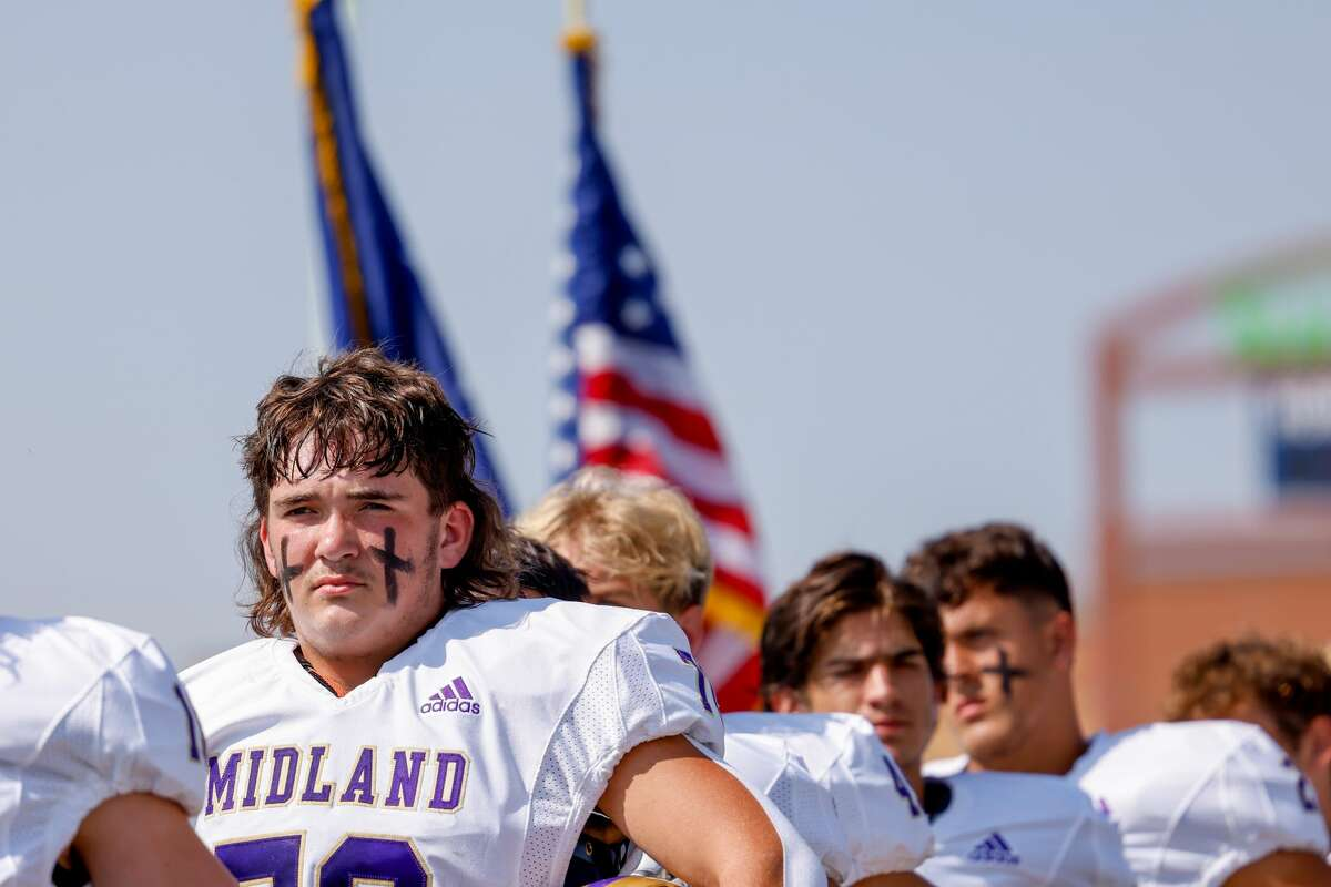 Midland High's John Guedry stands for the National Anthem on Friday, September 10, 2021.