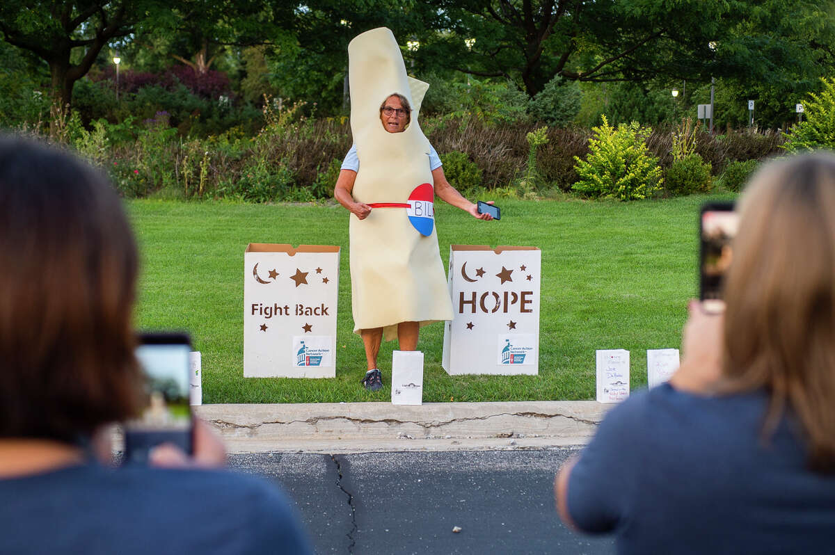 """Heidi Varner wears a """"bill"""" costume to advocate for cancer treatment legislations during the American Cancer Society Cancer Action Network's Lights of Hope fundraiser Friday, Sept. 11, 2021 at Dow Diamond. (Katy Kildee/kkildee@mdn.net)"""