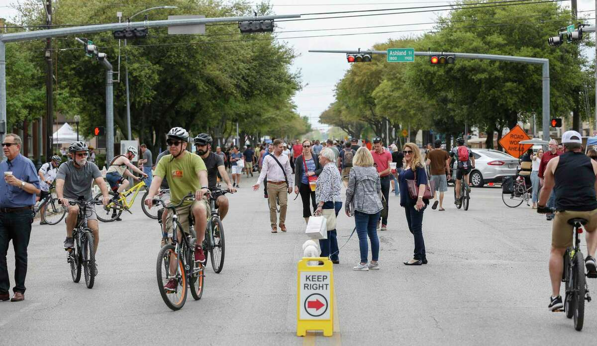 Yale Street between 19th St. and Shepherd Dr. was filled with bikes, roller-skates, dogs, children and other pedestrians during Cigna Sunday Streets in the Heights Sunday, March 24, 2019, in Houston. In its sixth year, Cigna Sunday Streets continues to spotlight Houston's most unique neighborhoods around the city with a focus on promoting alternative transportation, supporting neighborhood economies and a sense of community. This event gave Houstonians a chance to re-connect with their own neighborhoods and explore other new areas in the city.