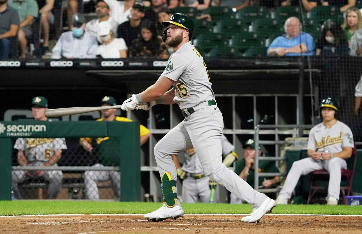 CHICAGO, ILLINOIS - AUGUST 18: Seth Brown #15 of the Oakland Athletics hits a home run against the Chicago White Sox during the fourth inning at Guaranteed Rate Field on August 18, 2021 in Chicago, Illinois. (Photo by David Banks/Getty Images)
