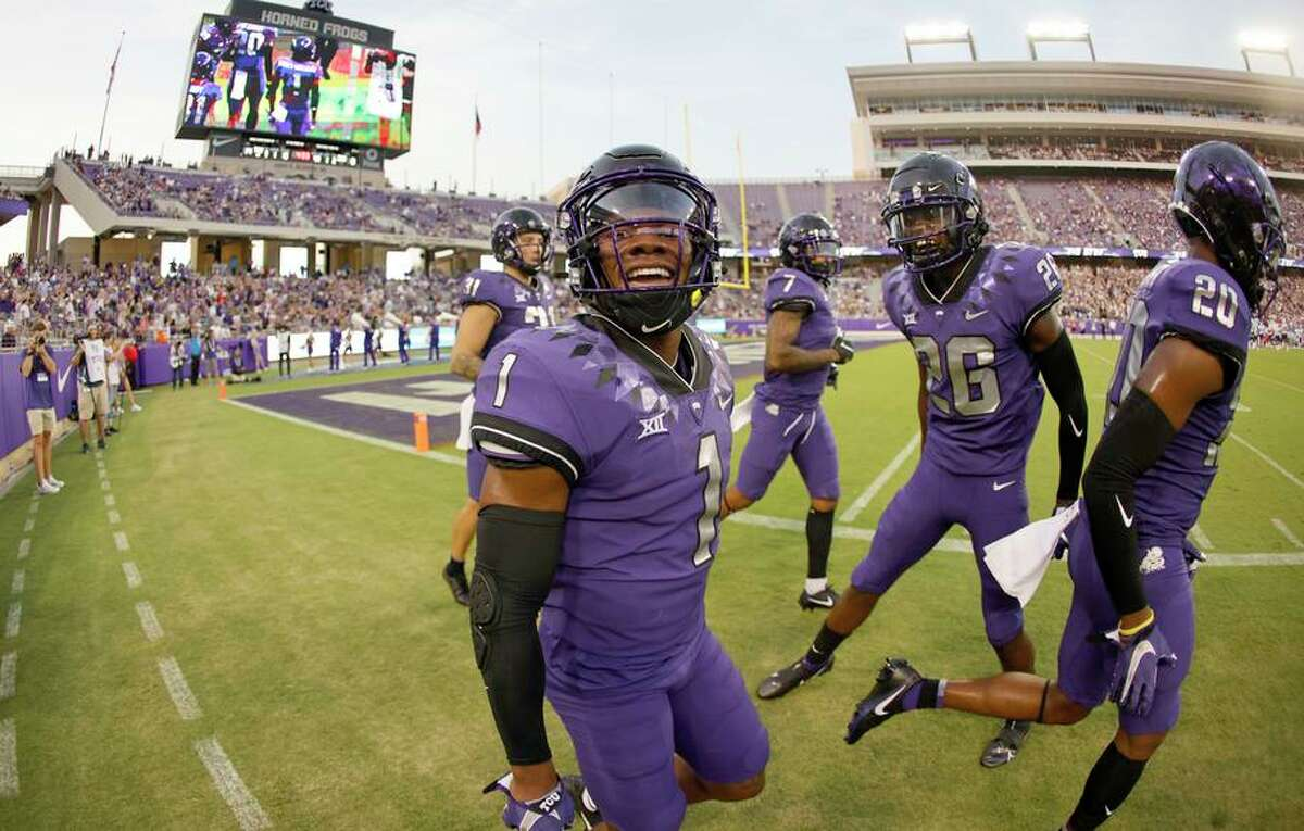 TCU's Tre'Vius Hodges-Tomlinson (1) reacts after intercepting a pass as Bud Clark (26) looks on against Duquesne on Sept. 4.