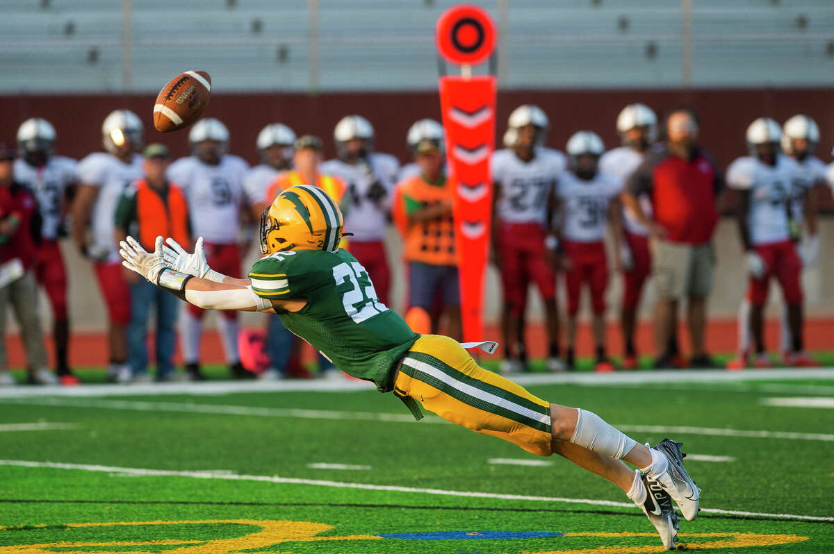 Dow's Carter Kohtz attempts to catch a pass during the Chargers' game against Grand Blanc Friday, Sept. 10, 2021 at Midland Community Stadium. (Katy Kildee/kkildee@mdn.net)