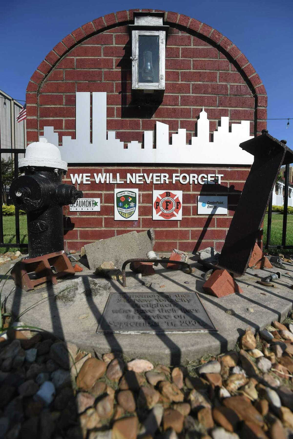 A memorial to the 434 firefighters who died on September 11, 2001, sits outside the downtown Beaumont fire station. Photo made Friday, September 10, 2021 Kim Brent/The Enterprise