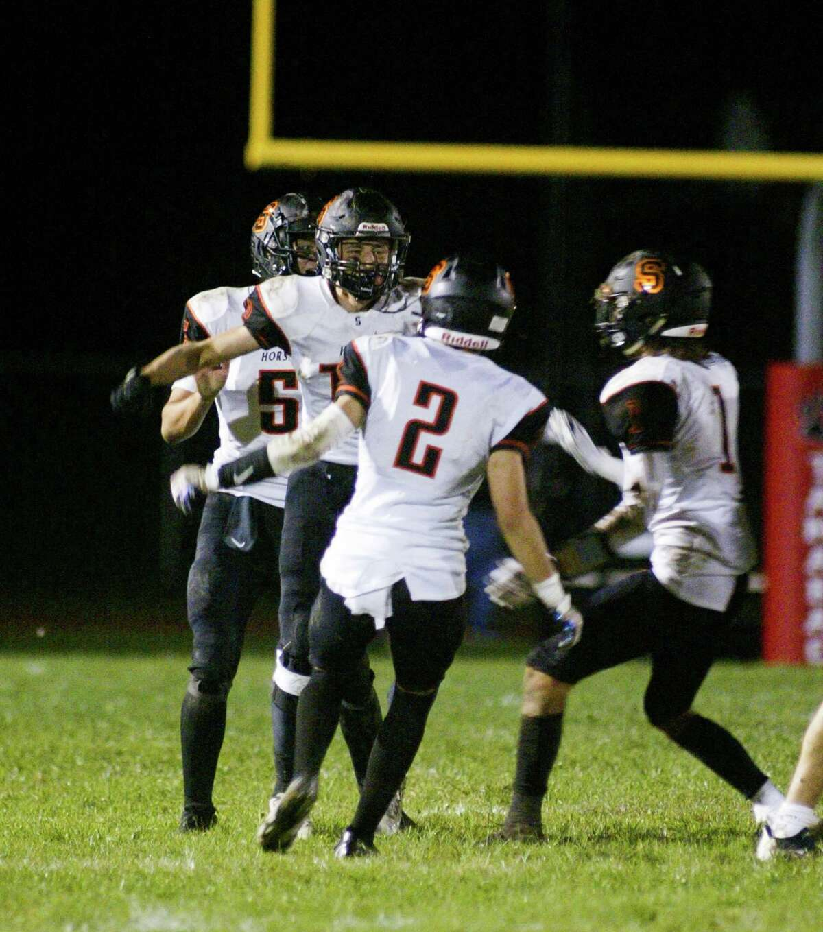 Ryan Dow, center, of Schuylerville, celebrates his late fourth-quarter interception against Hoosick Falls/Tamarac during their game on Sept. 10, 2021. (Jon Winslow / Special to the Times Union)