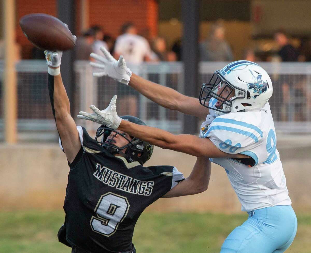 Andrews' Gehrig Morrid bresks up a two-point conversion attempt pass to Greenwood's Zane Ogle 09/10/2021 at Andrews' Mustang Bowl. Tim Fischer/Reporter-Telegram