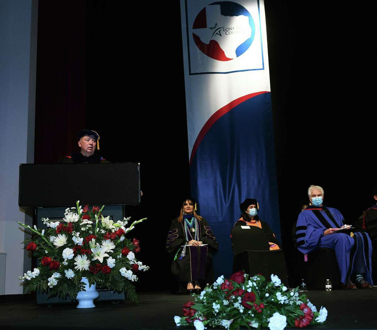 Stephen C. Head, Ph.D., Lone Star College chancellor gives opening remarks at the pinning ceremony for the first RN to BSN graduates in the history of the school.