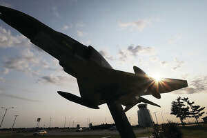 The sun rises above the F4 Phantom fighter jet Friday morning at St. Louis Regional Airport in Bethalto. On September 11, 2001, air traffic of every kind was ordered to land immediately.