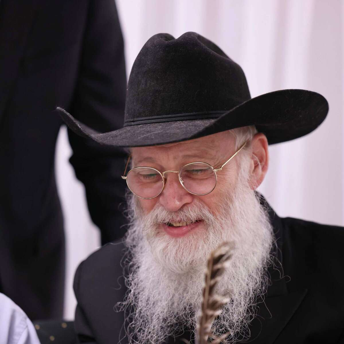 Fifth-generation scribe Rabbi Moshe Klein gets a taste of Texas while visiting from Crown Heights in Brooklyn, N.Y. Klein was at The Shul of Bellaire for the completion and dedication of the Unity Torah.