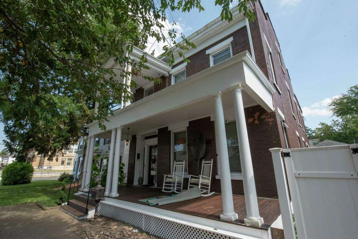 Exterior of the Enslin House at 562 Fifth Ave. on Wednesday, Sept. 8, 2021 in Troy, N.Y. The house, considered to be haunted and site of a dinner club where Legs Diamond dined, is for sale for $444,444.