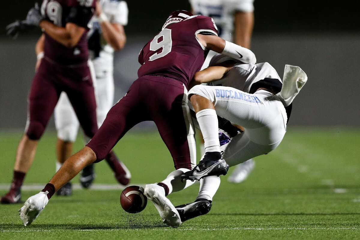 Cinco Ranch Cougars Yetxiel Perez Gilbes (9) breaks up a pass intended for Brazoswood Buccaneers wide receiver Cole Hagen (5) during the second half of the high school football game between the Brazoswood Buccaneers and the Cinco Ranch Cougars at Legacy Stadium in Katy, TX on Friday, September 10, 2021. The Cougars defeated the Buccaneers 48-14.