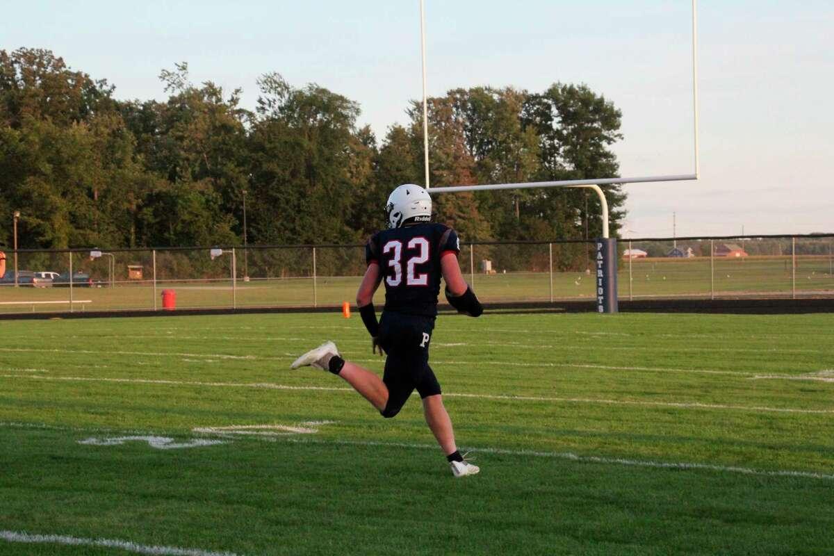 Braylon Ballard runs toward the end zone for a Touchdown.(Tom Greene/Huron Daily Tribune)