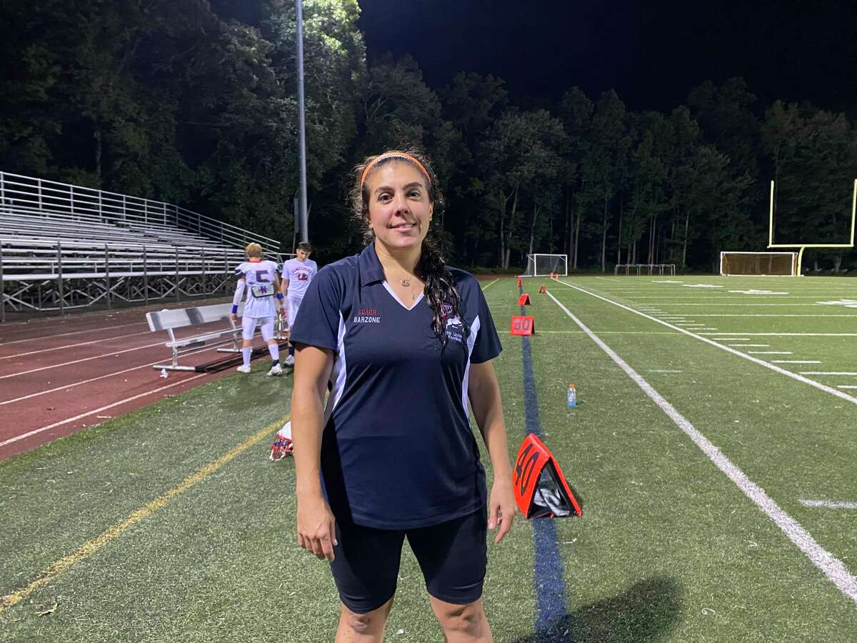 Northwest United's head coach Jenn Stango Garzone becomes the first female head coach to win a Connecticut high school football game after the Work Horses' season-opening win over Platt Tech.