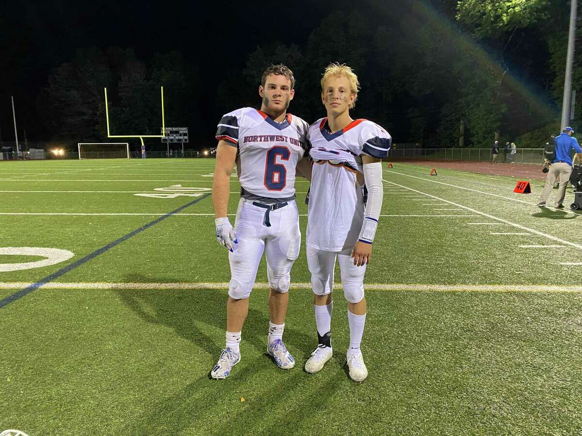 NWU's senior running back Jason Marques (left) and senior quarterback Ben Conti help lead the Work Horses to the co-op's first win in team history in the 2021 season opener over Platt Tech.