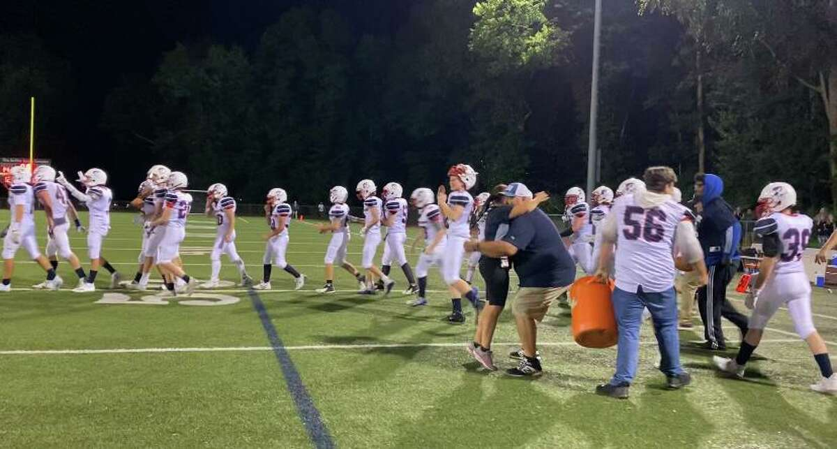 Northwest United's head coach Jenn Stango Garzone became the first female head coach to win a Connecticut high school football game after the Work Horses' season-opening win over Platt Tech.