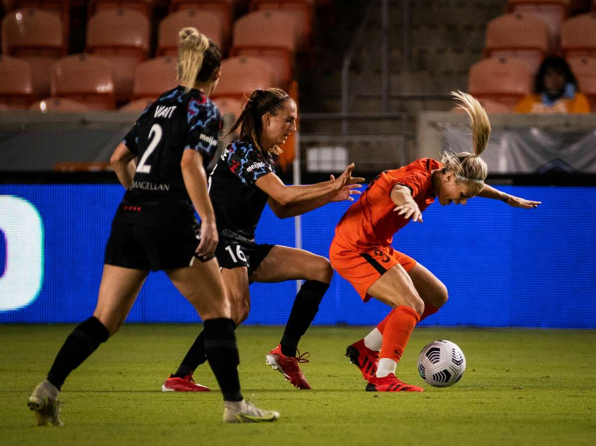 Chicago Red Stars midfielder Sarah Woldmoe (16) pushes Houston Dash forward Rachel Daly (3) during the second half of the game at BBVA Stadium, Friday, Sept. 10, 2021, in Houston. The game ended in a tie 1-1.