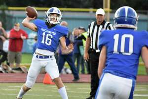 Southington quarterback Jack Barnum throws a pass in a football game against Maloney at Fontana Field, Southington on Friday, Sept. 10, 2021.