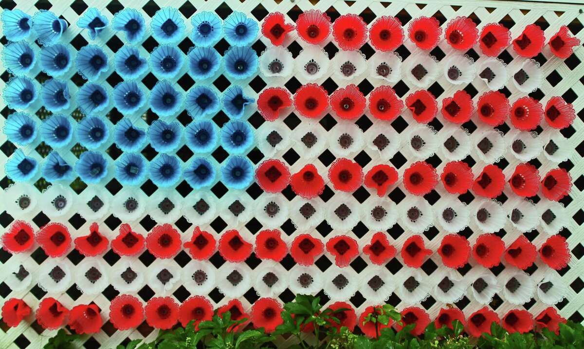 Darien artist Robert Carley made this American flag on the side of his house out of badminton birdies.
