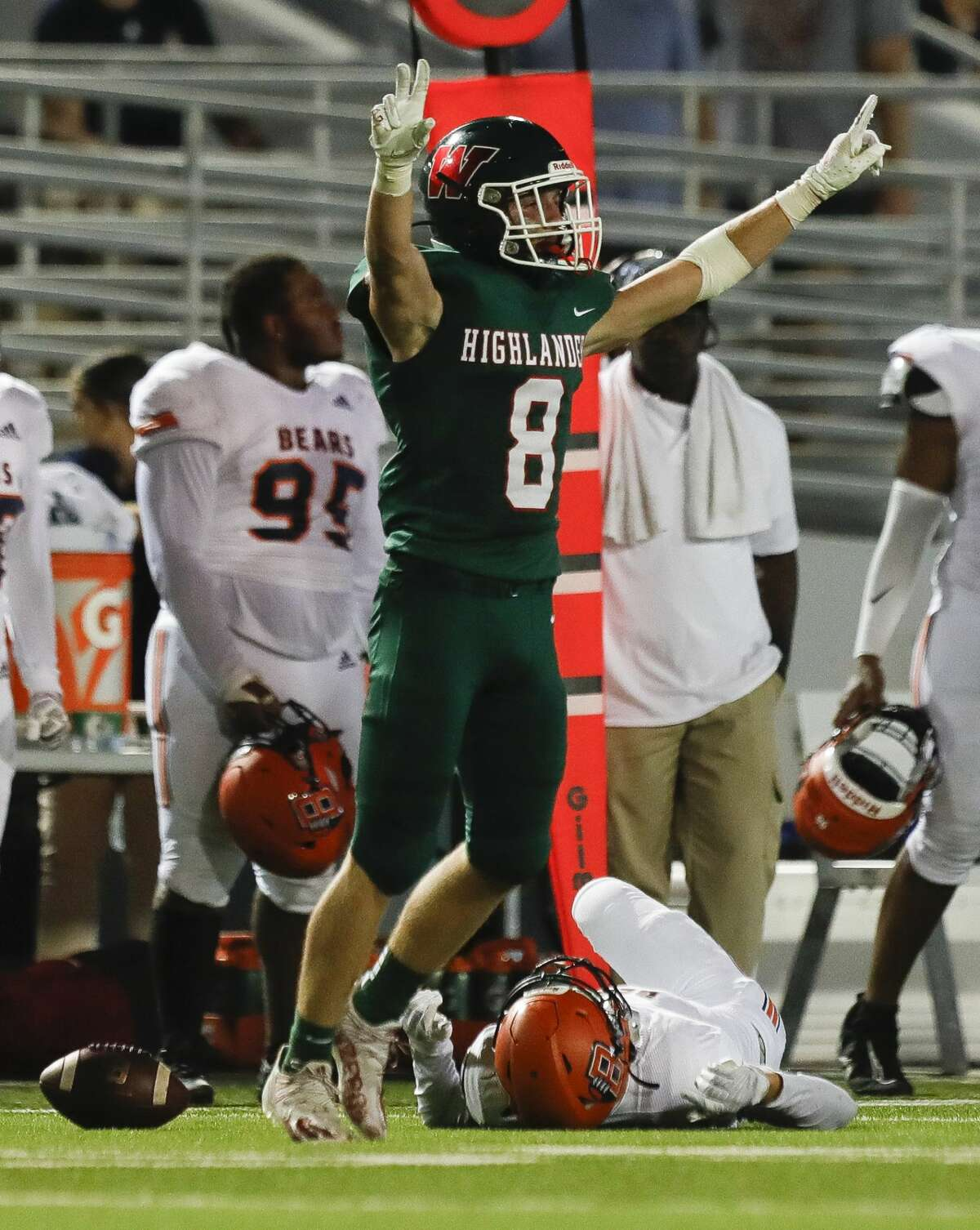 The Woodlands defensive back Brady Carlin (8) reacts after breaking up a pass to Bridgeland wide receiver Andrew Maleski (6) during the fourth quarter of a non-district high school football game at Woodforest Bank Stadium, Friday, Sept. 10, 2021, in Shenandoah.
