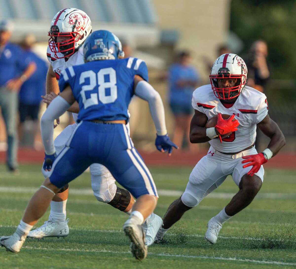 New Braunfels Canyon running back Cameron Bibins, right, runs for yards Friday night Sept. 10, 2021 While trying to avoid the Unicorns'' Cade Becvker during the Cougars' game against the New Braunfels Unicorns.