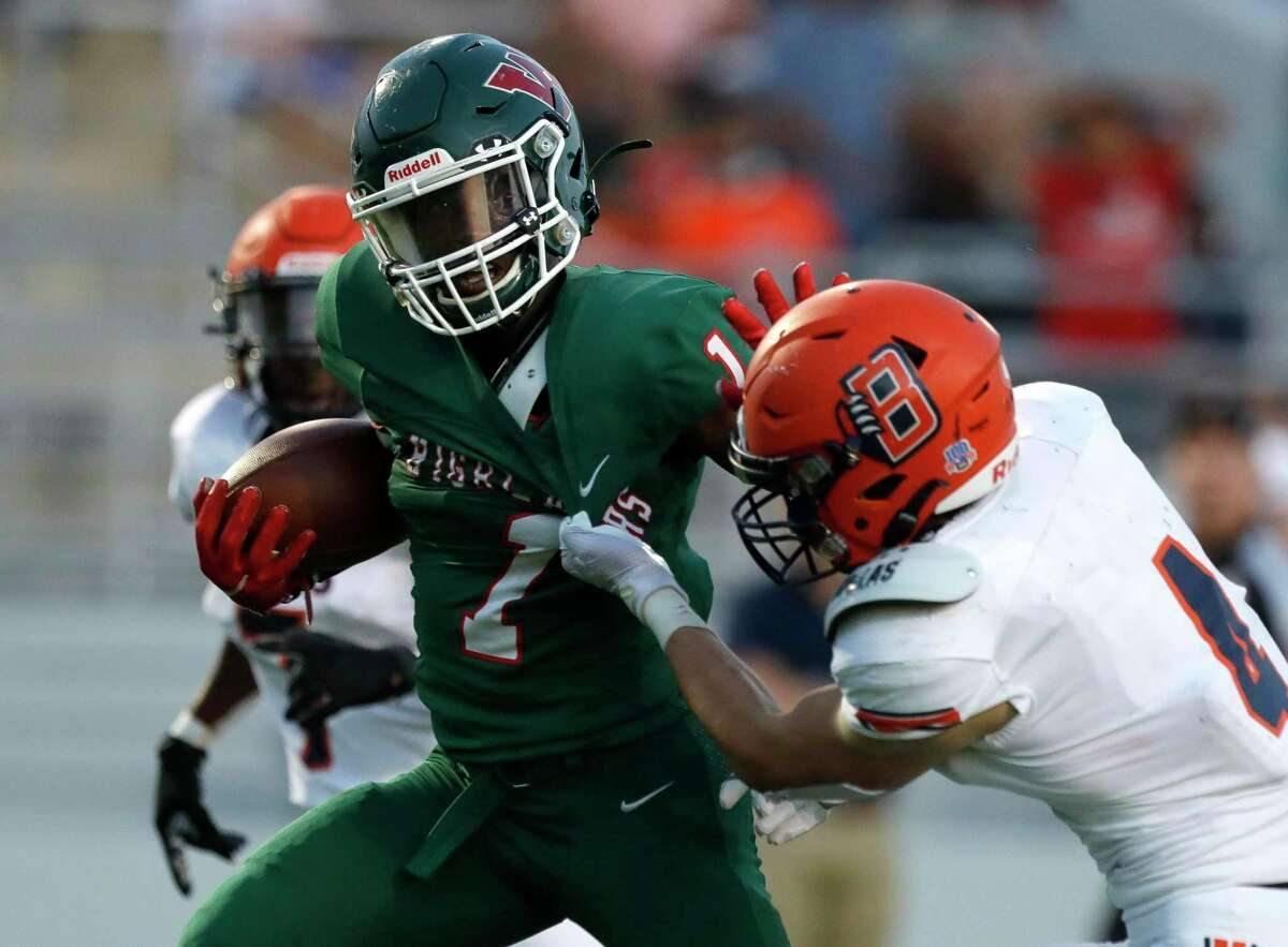 The Woodlands running back JoBarre Reed (1) shoves Bridgeland defensive back Graham Gillespie (4) on his way to a 27-yard touchdown during the first quarter of a non-district high school football game at Woodforest Bank Stadium, Friday, Sept. 10, 2021, in Shenandoah.