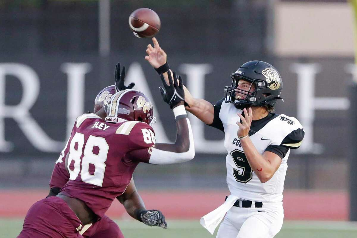 Conroe quarterback Clayton Garlock (9) passes the ball under pressure from Summer Creek's Karmari Weatherspoon (99) and Raj Kotak (88) during the first half of their non-district high school football game at George Turner Stadium Friday, Sept. 10, 2021 in Humble, TX.