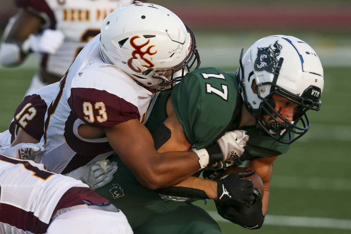 Clear Falls Knights wide receiver Luke Vidal (17) is tackled by Deer Park Deer defensive end Anthony Ortegon (93) in the first half on September 10, 2021 in a non district football game at Challenger-Columbia-Stadium in Webster, TX.