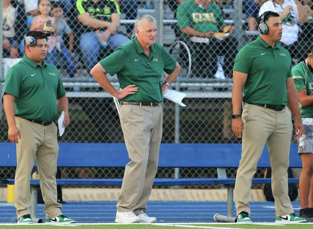 McCollum head coach Carl Klann (center) keeps an eye on his team from the sidelines during the game against Somerset in Somerset on Friday, Sept. 10, 2021.