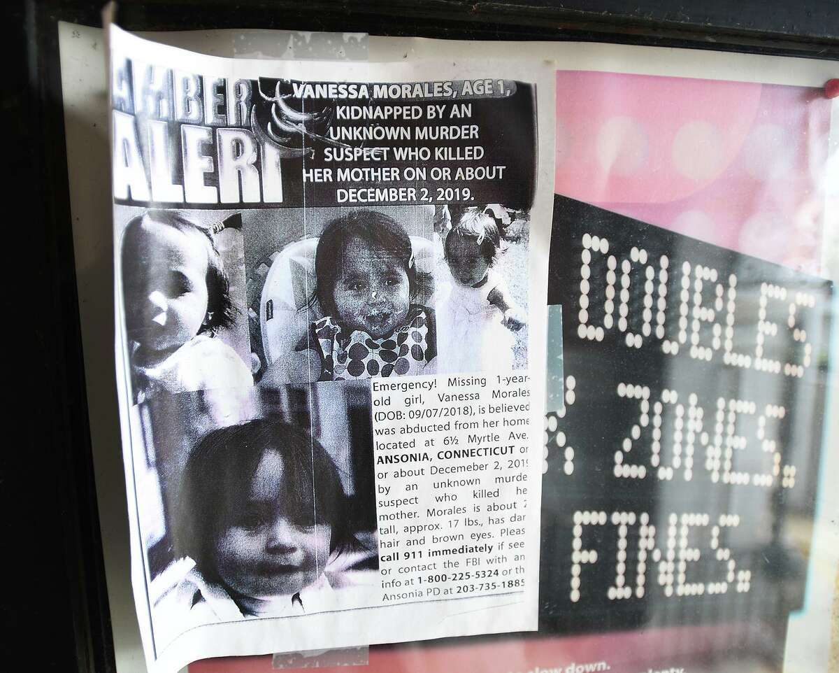 An old, curled flyer alerts the public to the hunt for missing toddler Vanessa Morales outside Ansonia City Hall on the one year anniversary of her disappearance from her home in Ansonia, Conn. on Tuesday, December 1, 2020.